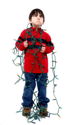 Boy in Tangled Christmas Lights