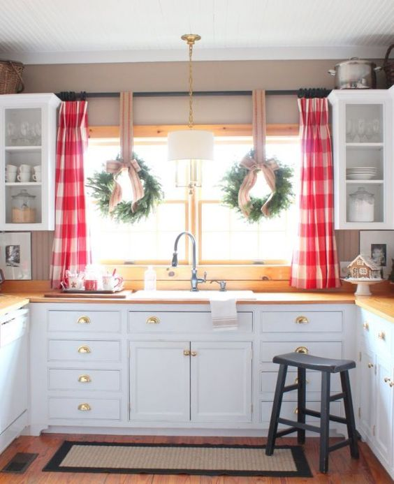 Christmas Wreaths over kitchen sink