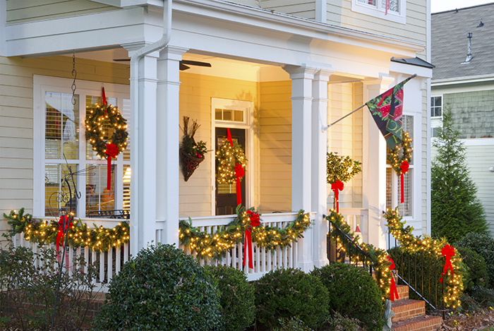 Christmas garlands and wreaths on front porch