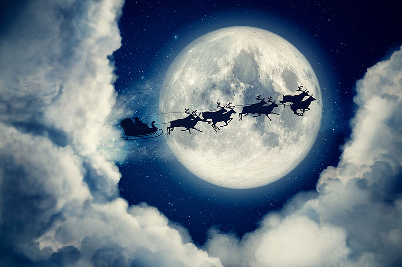 Santa Flying Through the Sky